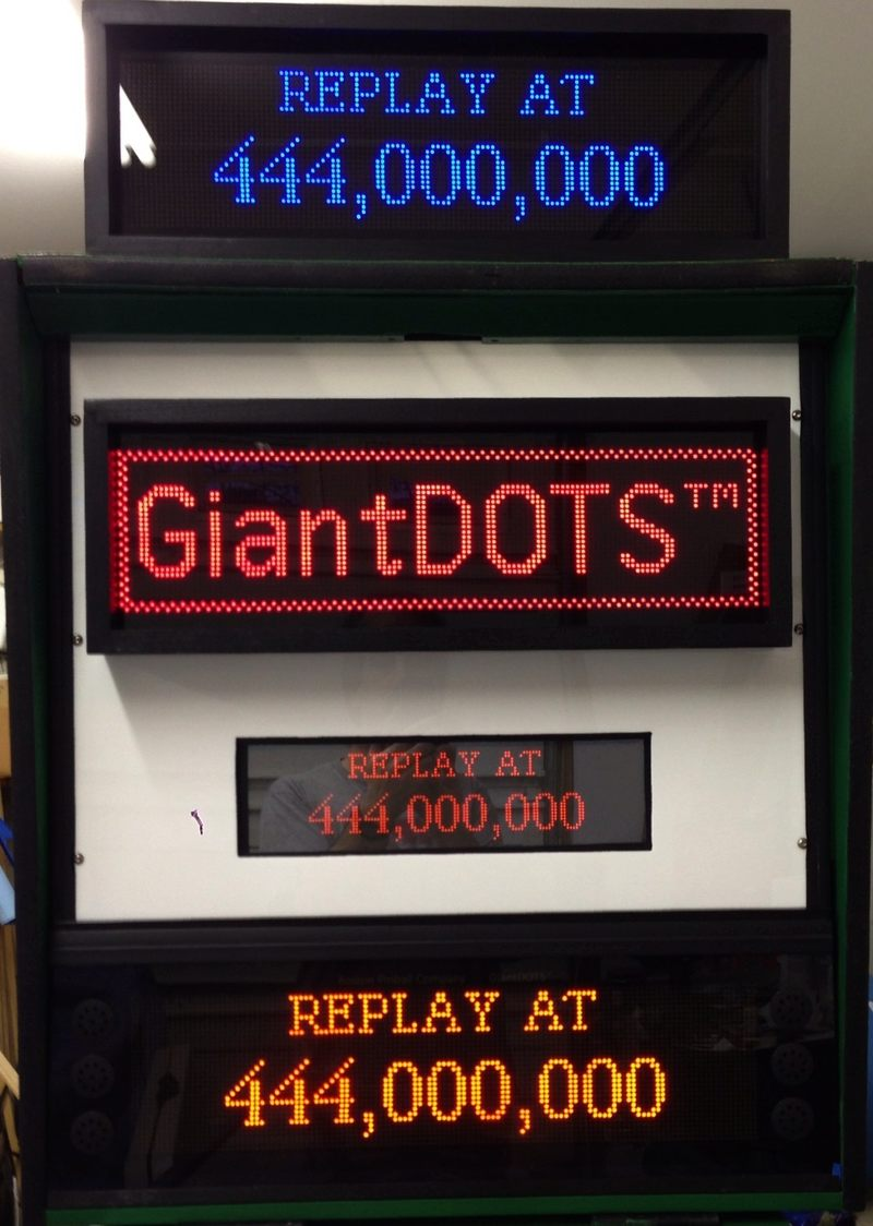 GiantDOTS Displays On our Ad Machine showing Blue, Red and Orange displays, compared to an original Plasma Display.